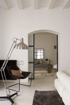 Arched pocket doors to office and guest bedroom to match style of house. White walls throughout.