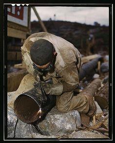 Welder cutting pipe. June 1942, Douglas Dam Tennessee.