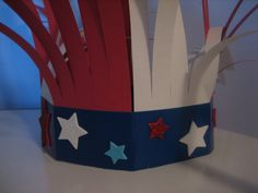 easy hat to make for 4th of july! so simple! construction paper, duct tape, stickers.
