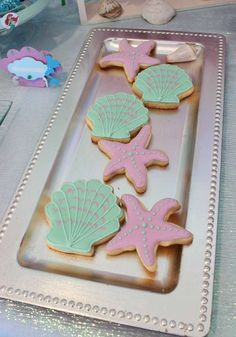Decorated sugar cookies at a Little Mermaid birthday party! See more party planning ideas at CatchMyParty.com!