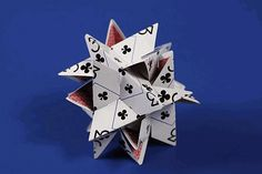 Here is a challenging star construction you can make from twelve playing cards.
