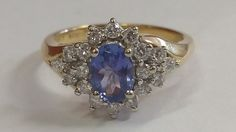 absolutely stunning 18k gold tanzanite diamond ring! a really beautiful ring.