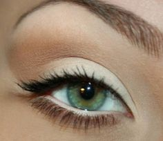 Natural look- white eyeshadow on lid, and a light brown in the crease... + a little black eyeliner on the top eyelid.