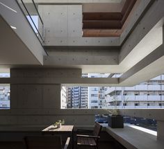 The concrete walls of this Tokyo house were designed by architect Hugo Kohno to step in and out, giving the building extra structural support while creating built-in shelves and seating.