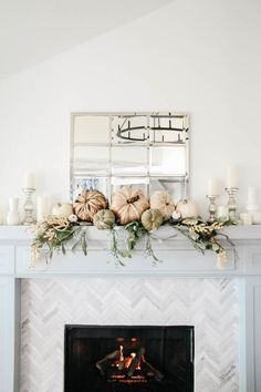Fireplace mantle decorated for fall. Natural pumpkins, neutral fall decor ideas for the living room. Fireplace mantle decorated for fall. Natural pumpkins, neutral fall decor ideas for the living room.