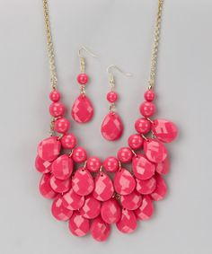 Stylishly unique, this contemporary necklace encourages elegant accessorizing. Bright teardrop-shape resin beads cascade like a waterfall in three rows from the chain as matching double-drop earrings complete a chic look.