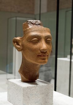Bust of Nefertiti now on display at the Neues Museum Berlin, found among many other sculptural items recovered by an German archaeological expedition under the leadership of Ludwig Borchardt (DOG) digging in Akhenatens deserted city of Akhetaton during its 1912 excavations, in the sculpture workshop of The Kings Favourite and Master of Works, the Sculptor Thutmose (also spelled Djhutmose and Thutmosis) in a ruined house and studio complex