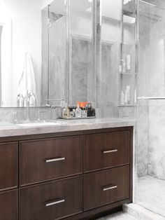 dark stained contemporary vanity with drawers, marble top