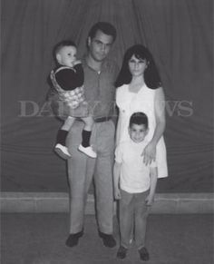 Photo from 1970 shows John Gotti holding his son Frankie Gotti and standing beside his wife Victoria Gotti with John (Junior) Gotti standing in front at Lewisburg Federal Penitentiary.