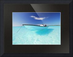 """""""Grand Turk Skiff II"""" by Jeff Monroe,  // A skiff floats in crystal water in the Caribbean. // Imagekind.com -- Buy stunning fine art prints, framed prints and canvas prints directly from independent working artists and photographers."""