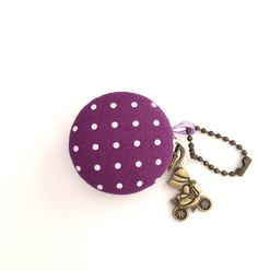 A personal favorite from my Etsy shop https://www.etsy.com/listing/453447982/macaron-coin-purse-jewelry-case-eggplant