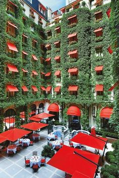 Hotel Plaza Athenee in Paris France. What an incredible courtyard vertical garden display! The front of the hotel is even better! Paris Hotels, Hotel Paris, Paris City, Hotel Plaza, Hotel Restaurant, Palaces, Oh The Places You'll Go, Places To Travel, Plaza Athenee Paris