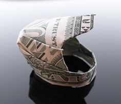 Dollar Bill Origami Motorcycle Helmet by craigfoldsfives on Deviant Art. So awesome!! | #motorcycles #helmets