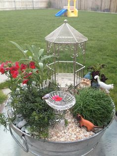 Miniature fairy garden planter.  I like the glass bowl in the center.