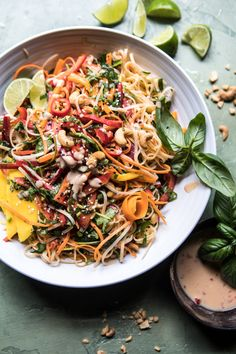 Rainbow Thai Basil Noodle Salad - loaded with veggies, made in under 30 mins, plus super pretty...the perfect simple summer salad! @halfbakedharvest.com
