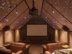 Unique media room with fun, glittering ceiling lights. Discovered on www.Porch.com