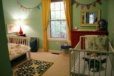 I do like this shared room. It's so realistic, but fun and whimsical. Look at the sweet sleeping baby in the crib. :)