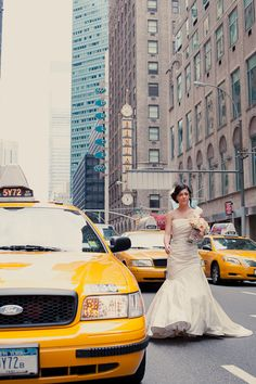 Bride + yellow cabs = only in New York City wedding. Photo by Fiona Conrad.