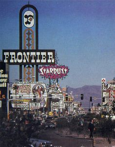 That is a lot of signage Postcard: Las Vegas Strip, c. December 1984. Siegfried & Roy at the Frontier. Boy-Lesque at Silver Slipper.  Thanks Shari