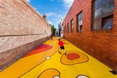 Reminds me a bit of laneway golf [See the article via link] No ordinary road: Melbourne laneway painted yellow in road safety initiative Landscape Concept, Landscape Architecture, Landscape Design, Modern Playground, Linear Park, Urban Intervention, Urban Village, Public Space Design, Murals Street Art