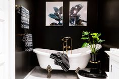 Beautiful dark bathroom with gold details. From carolinebergeriksen.no