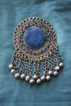 Round tribal embellishment £7