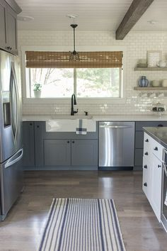 This kitchen is a stunner - from the floor to ceiling subway tile to the plank ceiling to the gray cabinets ... eclecticallyvintage.com