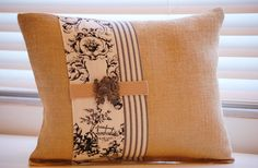 Rectangular burlap toile and french ticking pillow with vintage brooch. $55.00, via Etsy.