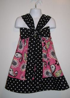 Pillowcase dress. @Paula Cook-do you think mom could do this for a project with all that pillowcase material?!