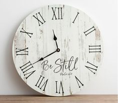 'Be Still' wooden wall clock. This wooden analog wall clock features a distressed backdrop paired with Roman numerals and vintage-inspired hour and minute hands. Farmhouse Fireplace Mantels, Farmhouse Clocks, Modern Farmhouse, Farmhouse Style, Farmhouse Decor, Big Wall Clocks, Kitchen Wall Clocks, Clock Wall, Clock Decor