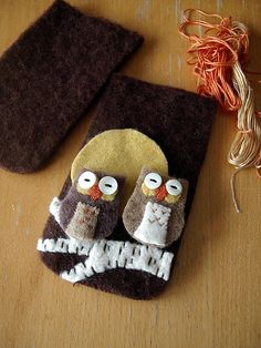 Working on an eyeglass case today of felted wool from upcycled sweaters.  Two litle owlies perch on a birch.