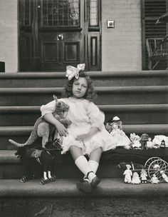 """Marcia on the front steps of Harll, 10.05.1911. """"It was really Marcia's 6th birthday on Monday, but for some special reasons it was kept up to-day [Wednesday] and her presents given to her this morning. [This photograph was] taken on the front steps of 'Harll' just after breakfast. Marcia had a party at the Pantomime in the afternoon."""""""