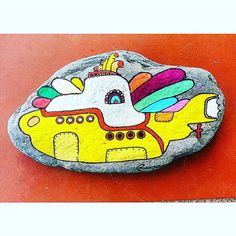 Colorful yellow submarine painted on stone!