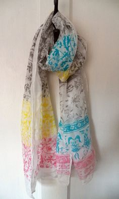 Hand screen printed silk habotai scarf with pink, blue, yellow and grey pattern by Holly Eden