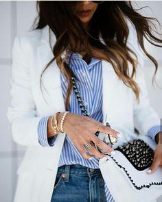 Spring elegance with white blazer, striped shirt and denim jeans.
