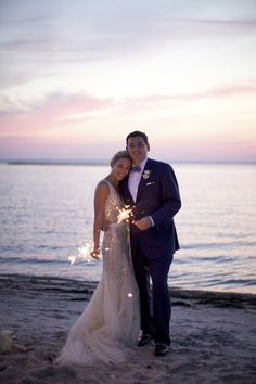 Nothing says summer wedding like sparklers on the beach! Photo by: Sarah DiCicco