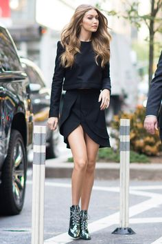 Best dressed this week: 31 October -- 2 November Gigi Hadid was spotted in a black jumper and skirt, teamed with the Stuart Weitzman boots she designed, as she headed into a Victoria's Secret fitting in New York.
