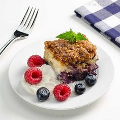 Blueberry Buckle with ice cream, berry, and mint garnish