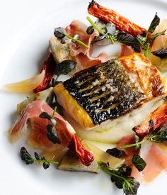 Matthew Tomkinson uses sea bass as the centrepiece to a lavish salad, serving with both globe and Jerusalem artichokes and a red wine sauce. Fish Recipes, Seafood Recipes, Gourmet Recipes, Cooking Recipes, Gourmet Desserts, Fish Dishes, Seafood Dishes, Fish And Seafood, Food Porn