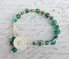 White hemp bracelet with blue green by OnTheWireByMaryJane on Etsy, $20.00