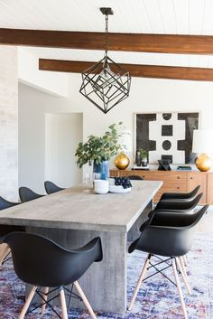 0bcb338e96a6 Eclectic mid-century modern dining room design with a mostly neutral  palette featuring a poured