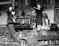 """Dec. 29, 1941 Factory workers in a Ministry of Supply factory fit a gun mounting on a """"Matilda"""" tank."""