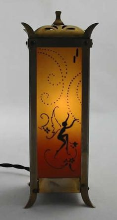 Rare Art Deco scent or perfume lamp with frolicking fairy figures enameled on a coloured glass insert by Devilbiss, ca.1920s or 30s