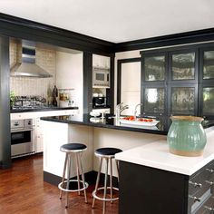 Life of the Party            Kitchens are a gathering place for guests and family alike. This black-and-white space welcomes everyone in style. Touches of metal add contemporary flair to the classic color combination. Stainless steel extends from the appliances to the sink and faucet to the cabinet hardware
