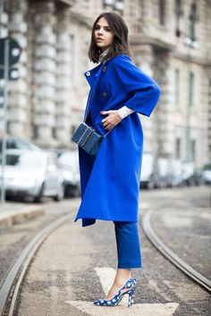 Bright blue coat and matching cross-body bag? Check and check for Golden Diamonds, who makes one pretty blue monochromatic outfit