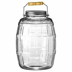 """Perfect for holding sweets in your kitchen or office supplies in the den, this charming glass jar showcases a barrel-inspired design and wood handle.  Product: JarConstruction Material: Glass, aluminum and woodColor: Clear, silver and naturalFeatures:  2.5 Gallon capacityMade in the USADimensions: 14"""" H x 9.8"""" Diameter Cleaning and Care: Hand wash"""
