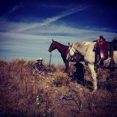 Cowboys and horses taking a break at Zapata Ranch. #ZapataRanch