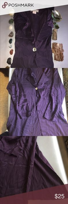 "Vintage 100% silk dark purple long tunic Vintage 100% silk dark purple long tunic shirt. Has a single abalone shell button. A v neck with collar. Two long side slits on either side of hemline. Shirt is 36"" long. Sleeves are 23"" long. Bust is 42"".Made in America! Dry clean only. In excellent condition. No odors. Smoke free and pet friendly. Thanks for looking! Rialto collection by Joy Perreras Tops Tunics"