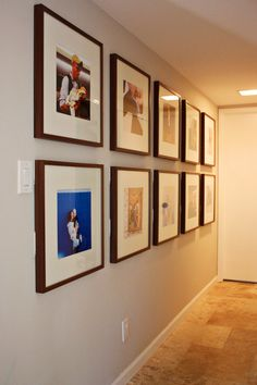 hallway of framed photos