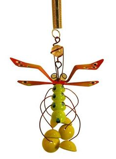 """Garden Ornamental Lime Green Dragonfly with Chimed Feet, on Garden Stake by BouncySprings. $15.00. INCLUDED WITH A GARDEN STAKE (20""""). ORNAMENT FOR THE GARDEN AND HOME. MADE OF STEEL AND COPPER, HAND PAINTED AND PROTECTED WITH AN OUTDOOR FINISH. FEET CHIMES. APPX. 4 1/2"""" X 6 1/2"""" X 5 1/2"""". Whimsical Lime Green dragonfly happily hangs over your flower bed or in our potted plant with the included stake."""